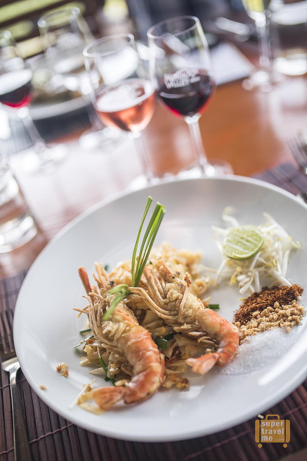 Dine at The Sala and enjoy a Pad Thai with a glass of wine