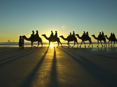 Ride a Camel at Sunset on Cable Beach in Broome, Western Australia.