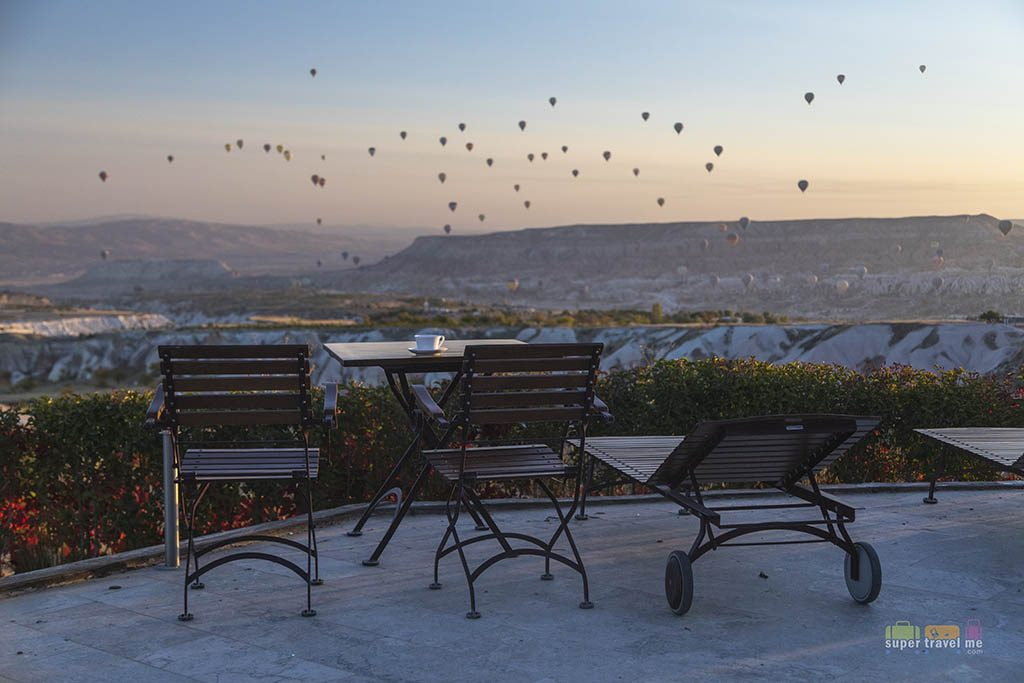 Enjoy a cuppa coffee during sunrise as you overlook the hot air balloons rising at Ariana Sustainable Luxury Lodge in Cappadocia, Turkey