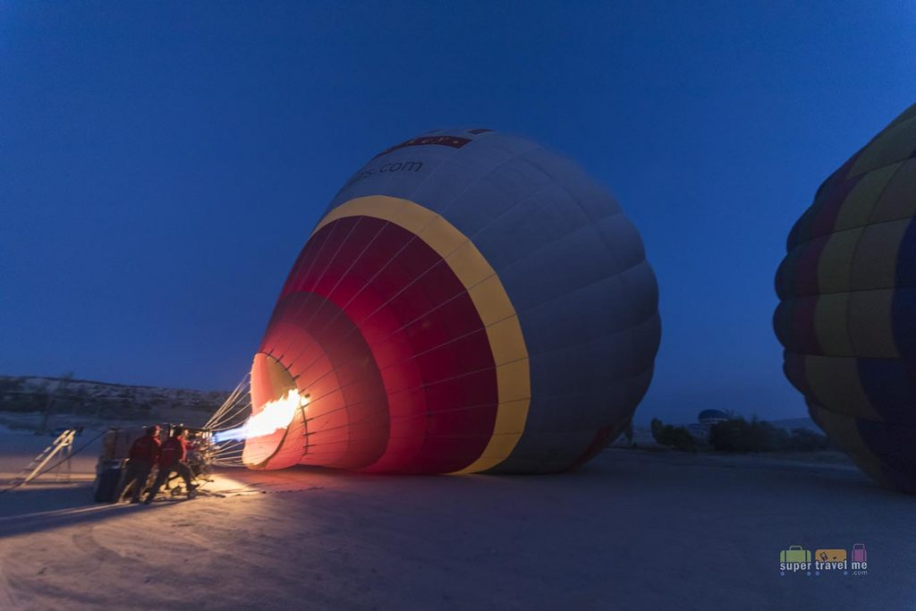 Getting up early before the sunrises for a hot air balloon ride