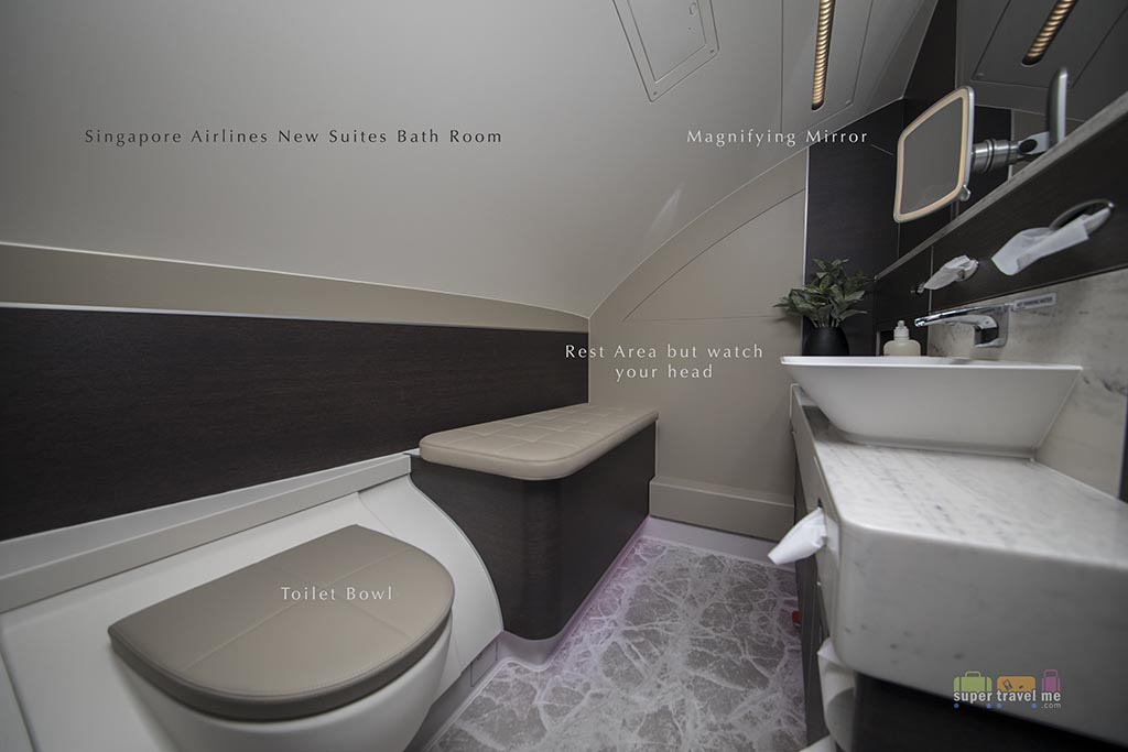 Singapore Airlines - The smaller Suites restroom on the left of the cabin.