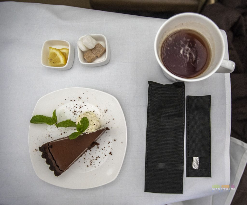 Chocolate tart with pistachio and mascarpone - Dessert onboard EY2