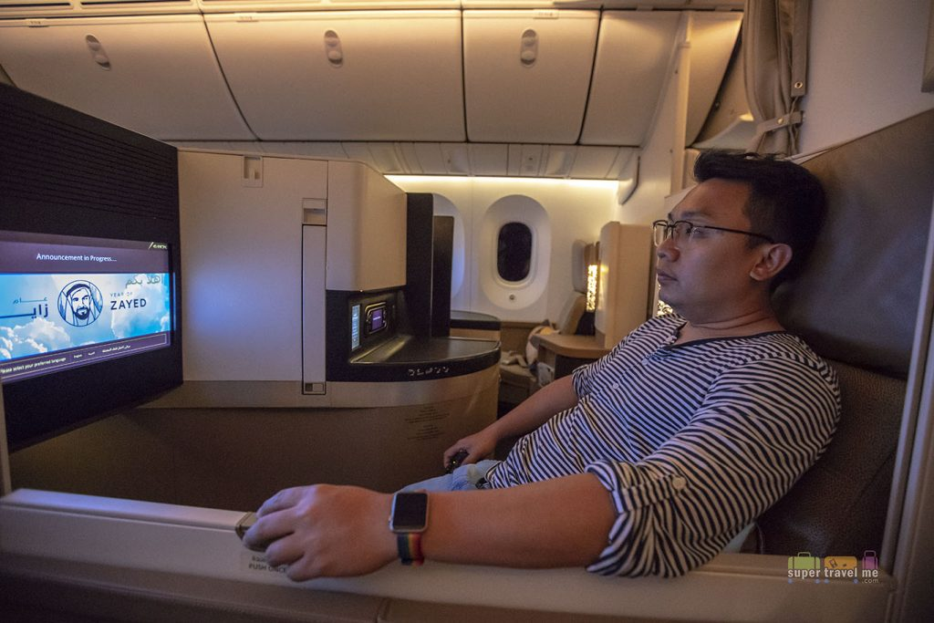 Watching a movie onboard Etihad Airways Business Studio cabin