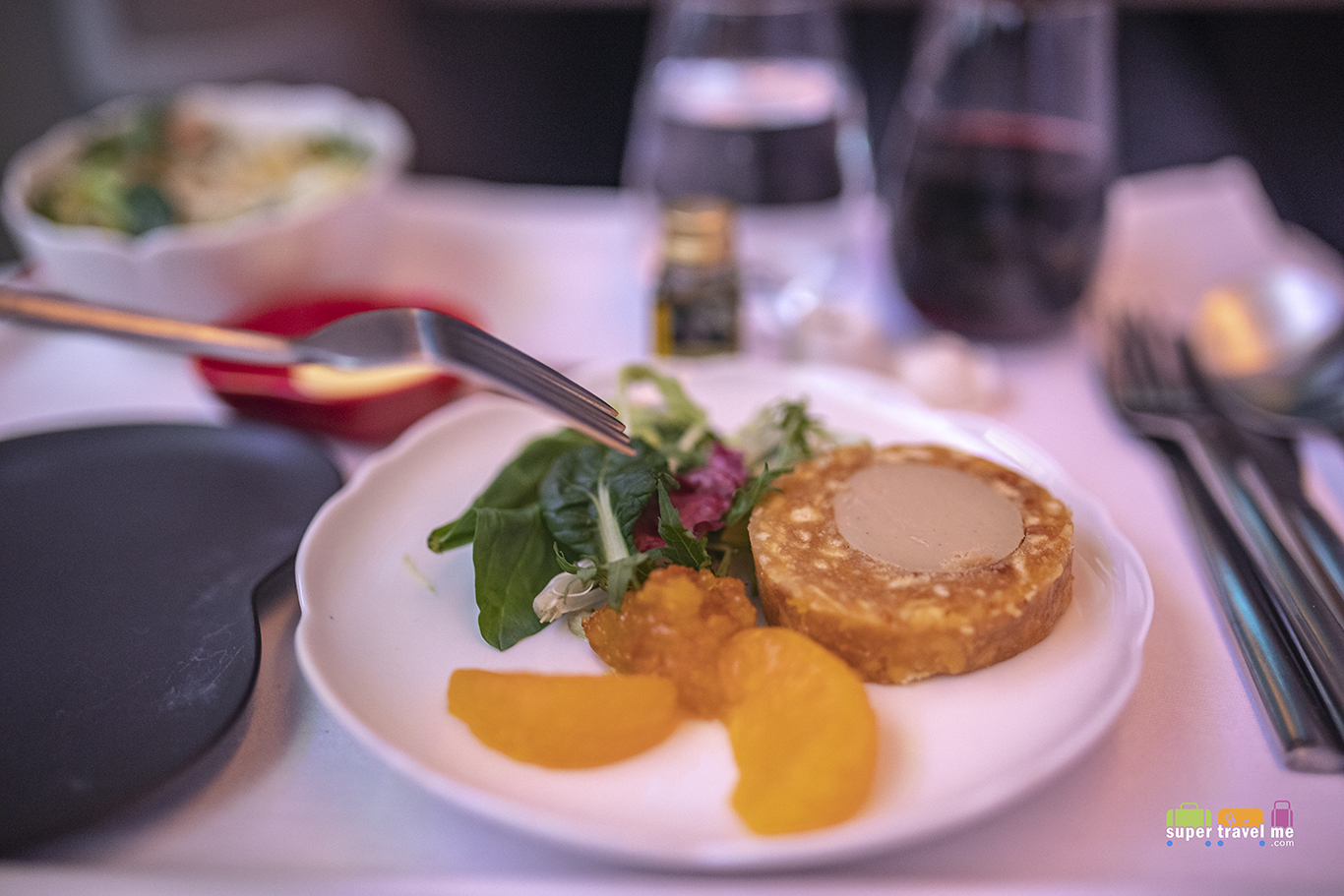 Starter on board Hong Kong Airlines flight from Hong Kong to Los Angeles - Foie grass stuffed sachima with a mandarin marmalade