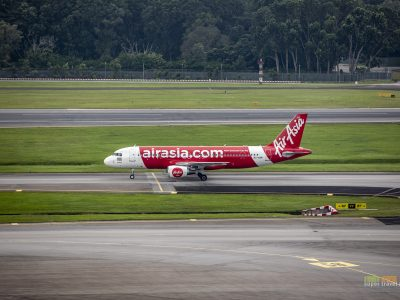 AirAsia aircraft taxiing at Singapore Changi Airport