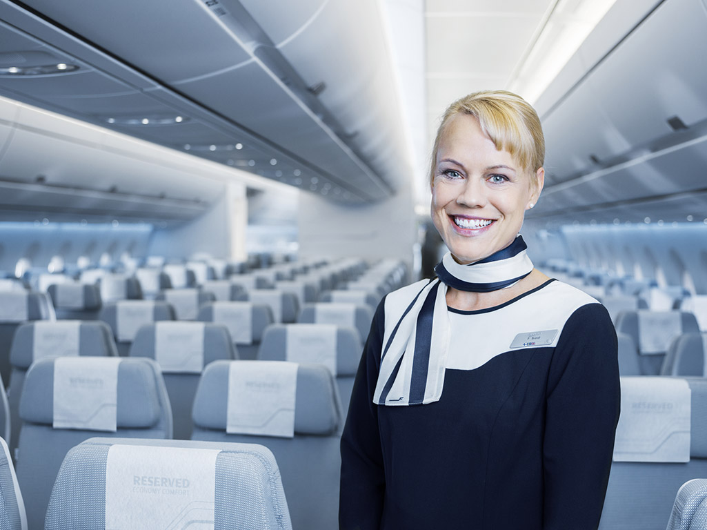 Finnair A350 economy class cabin with cabin crew member (Finnair photo)