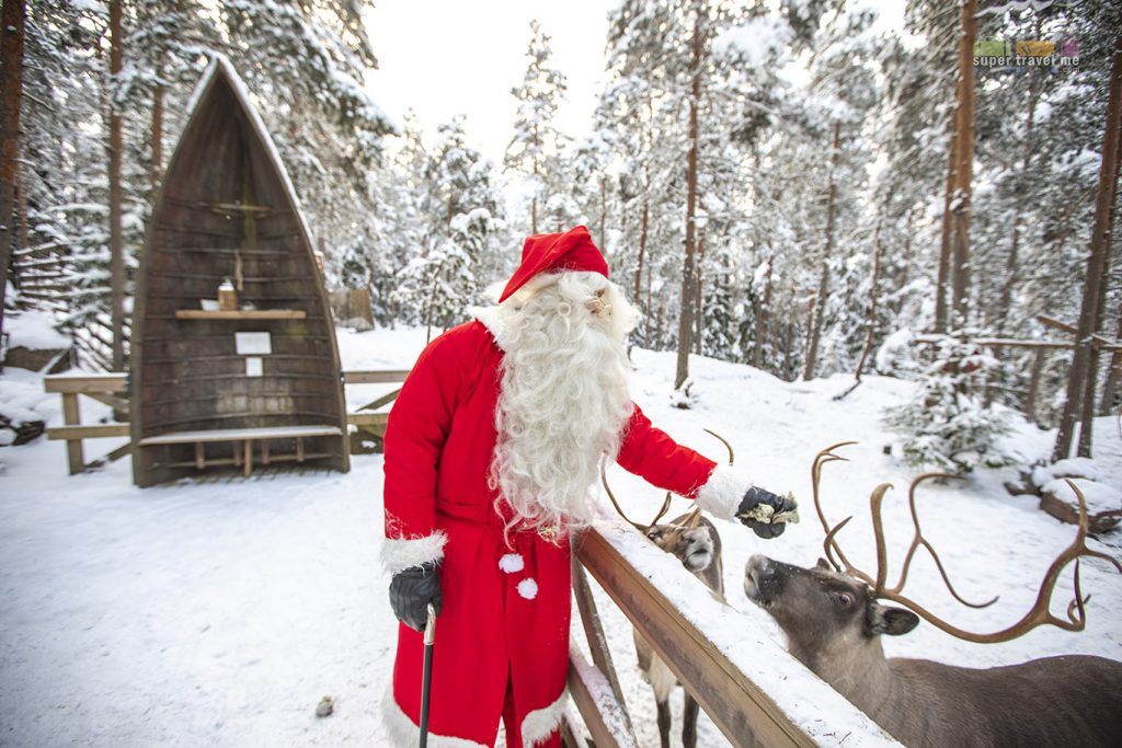Santa Claus and Reindeers at The White Reindeer Park in Espoo, Finland
