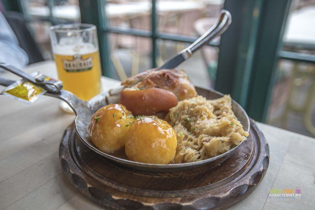 Bergmannspfanne  - Cured knuckle of pork with beer sauce, sauerkraut, potato dumpling and mustard from Brauhaus Zeche Jacobi on the CentrO Promenade