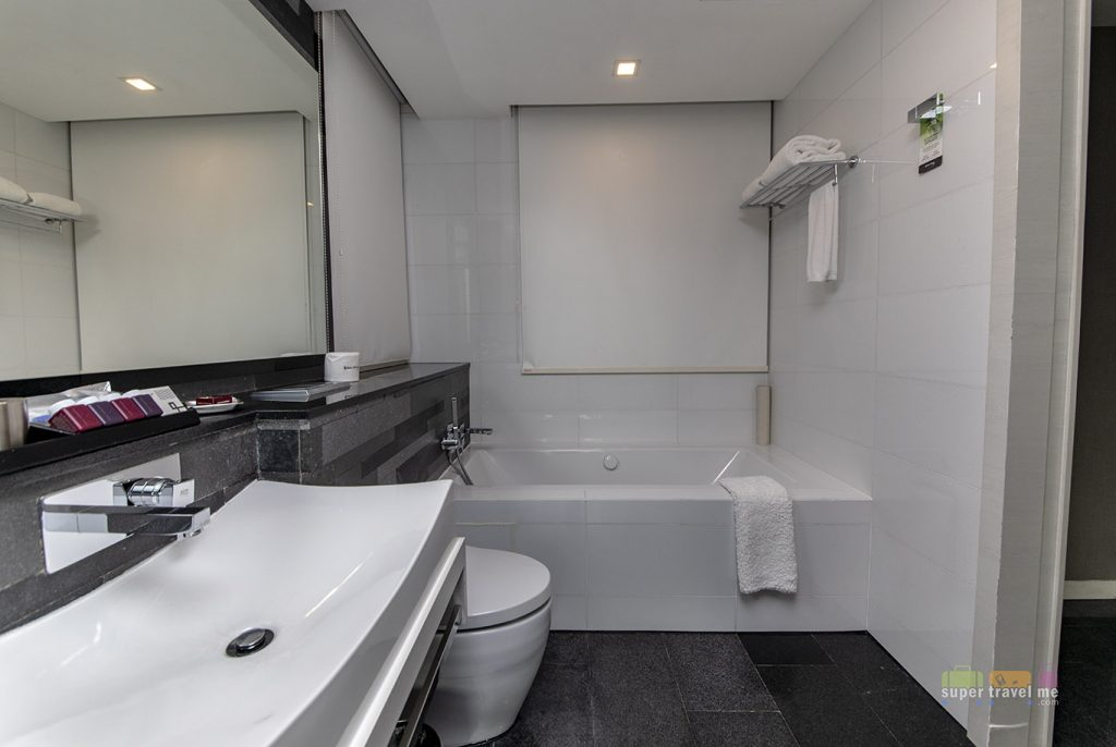 Spacious bathroom with bathtub at The Quincy Hotel Studio Deluxe Rooms