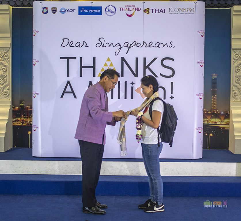 H.E. Weerasak Kowsurat, Minister of Tourism and Sports and Angela Kwek at the welcome ceremony at Bangkok Suvarnabhumi Airport