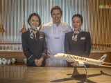 Chef Tommy Myllmäki flanked by two Finnair flight attendants at a media event at Lounge by the Pool in Conrad Centennial Singapore on 30 May 2019