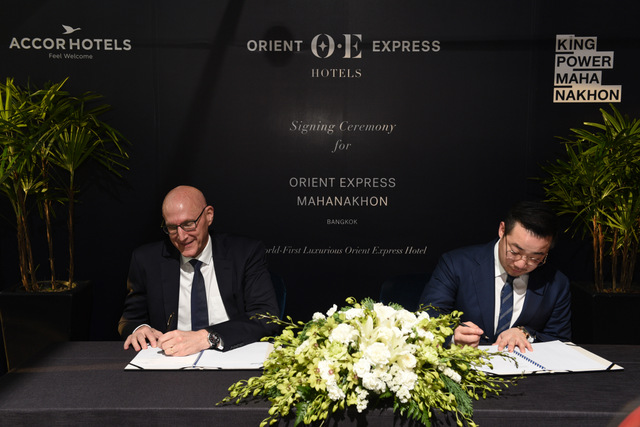 Aiyawatt Srivaddhanaprabha, Chief Executive Officer of King Power Group signs an MOU with Michael Issenberg, Chairman and Chief Executive Officer Asia Pacific of AccorHotels to debut the world's first Orient Express Hotel in King Power Mahanakhon—Bangkok's new landmark.(King Power Group photo