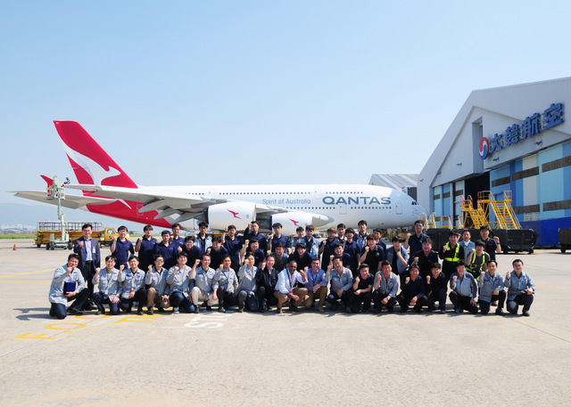 Employees of Korean Air and Qantas Airways pose together after Korean Air completed its first repaint of a Qantas A380 on May 24, at Korean Air's painting facility at Gimhae International Airport. (Korean Air photo)