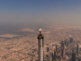 Emirates Cabin Crew on the tip of the Burj Khalifa by Emaar (Emirates photo)